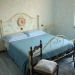 Letto della camera azzurra
